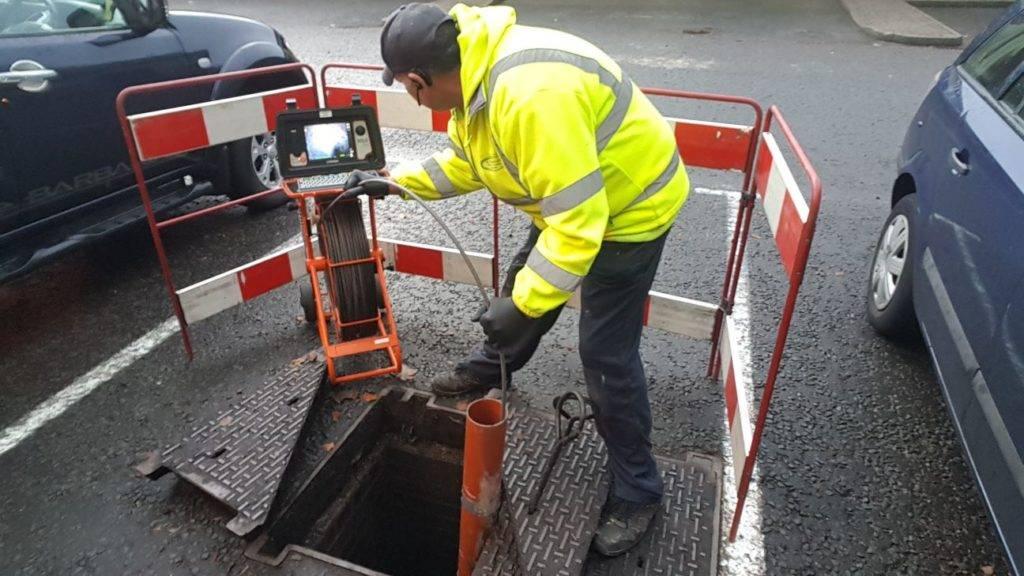 man using drain cctv camera
